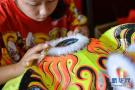 马来西亚的舞狮带路人