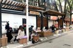 宁波北仑城管统一设擦鞋亭 便民同时还为从业者解决生计