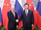 Xi, Putin hold talks on phone over ties, World Cup